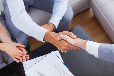 Shaking hands over a hubspot for startups deal