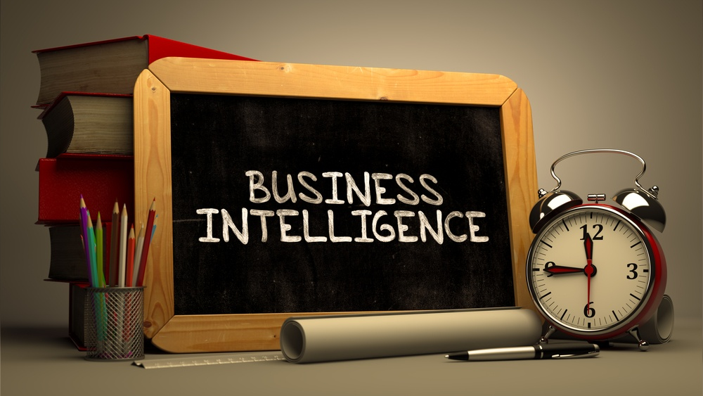 Business Intelligence Handwritten on Chalkboard. Time Concept. Composition with Chalkboard and Stack of Books, Alarm Clock and Scrolls on Blurred Background. Toned Image.