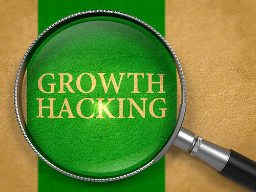 Growth Hacking through Loupe on Old Paper with Green Vertical Line Background. 3d.