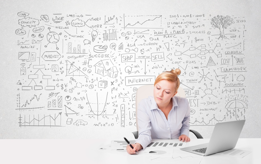 Pretty young businesswoman planning and calculating various business ideas.jpeg