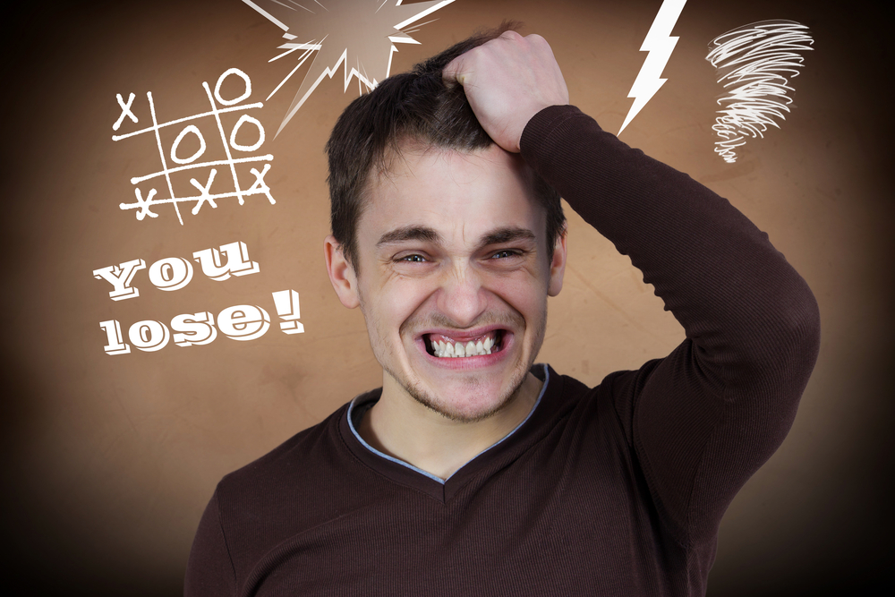 Closeup portrait goofy, funny face, young man slapping hand on head, upset he lost game isolated brown background tic tac toe. Negative human emotion facial expression feelings, body language reaction