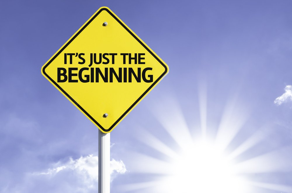 It's Just The Beginning road sign with sun background-1