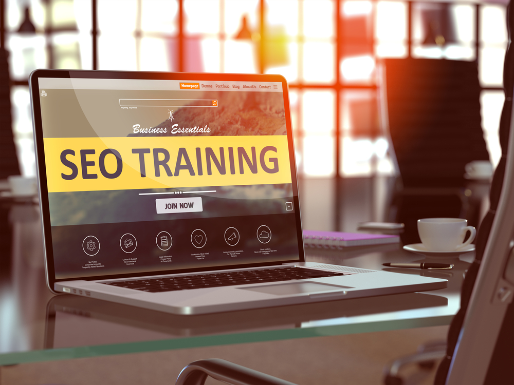 SEO - Search Engine Optimization - Training Concept. Closeup Landing Page on Laptop Screen  on background of Comfortable Working Place in Modern Office. Blurred, Toned Image. 3d Render.